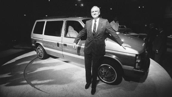 Lee Iacocca, chairman of the board of Chrysler Corporation, shows off Chryslers