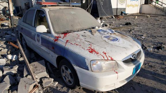 Bloodstains are seen on a police car at the scene of the airstrike on the migrant detention center.