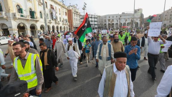Libyans call for an end to fighting during a demonstration against Haftar in Tripoli