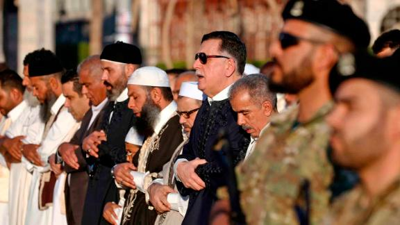 Government of National Accord Prime Minister Fayez al-Sarraj, fourth from right, performs Eid al-Fitr prayers at Martyrs Square in Tripoli on June 4.