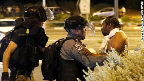 A member of Israel's Ethiopian community argues with a policeman in the coastal city of Netanya on July 2.