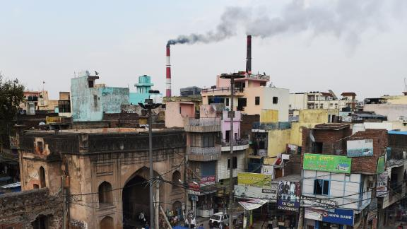 In this photograph taken on April 6, 2015, smoke billows from two smoke stacks at the coal-based Badarpur Thermal Station in New Delhi. A study by the Centre of Science and Environment in India found the plant which produces 705 MW (Megawatts) is one of the country's most polluting and inefficient power plants. Authorities insist they must focus on meeting the growing needs of its 1.25 billion people, 300 million of whom lack access to electricity. In its action plan for the Paris COP21 meet, India pledges to reduce its carbon intensity -- a measure of a country's emissions relative to its economic output -- by 35 percent by 2030, rather than an absolute cut in emissions.  Globally, India is the third largest carbon-emitting country -- though its per capita emissions are only one third of the international average -- according to the World Resources Institute.  AFP PHOTO / MONEY SHARMA