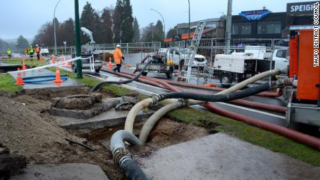 Pumps and sandbags are used to stem the flow of wastewater into Lake Taupo.