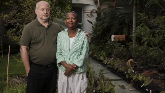 Hermine Ricketts and Tom Carroll were threatened with a daily $50 fine for growing a front-yard vegetable garden