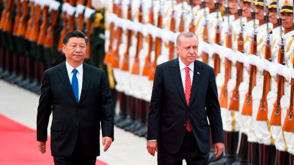Turkish President Recep Tayyip Erdogan and Chinese President Xi Jinping inspect Chinese honor guards during a welcome ceremony outside the Great Hall of the People in Beijing on July 2.