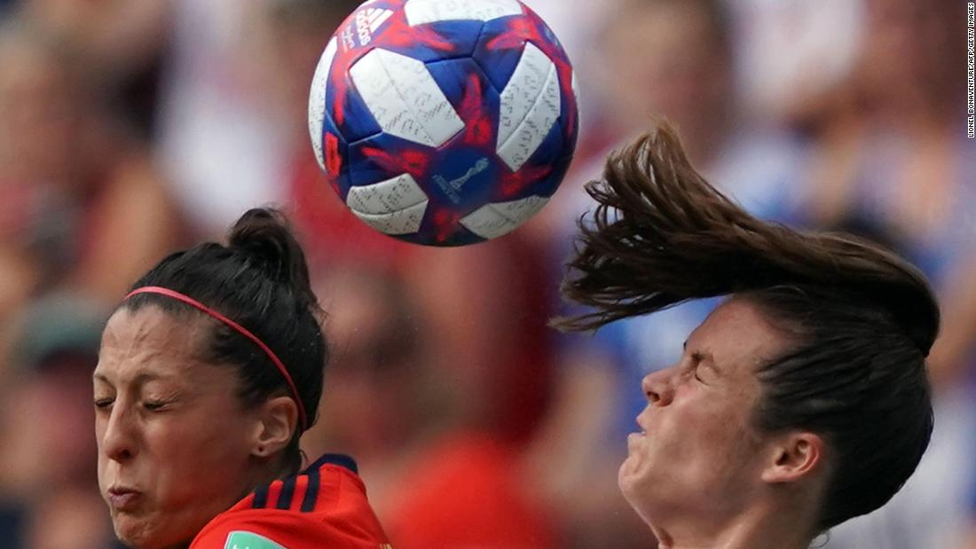 Spanish forward Jennifer Hermoso and US defender Kelley O'Hara compete for a header.