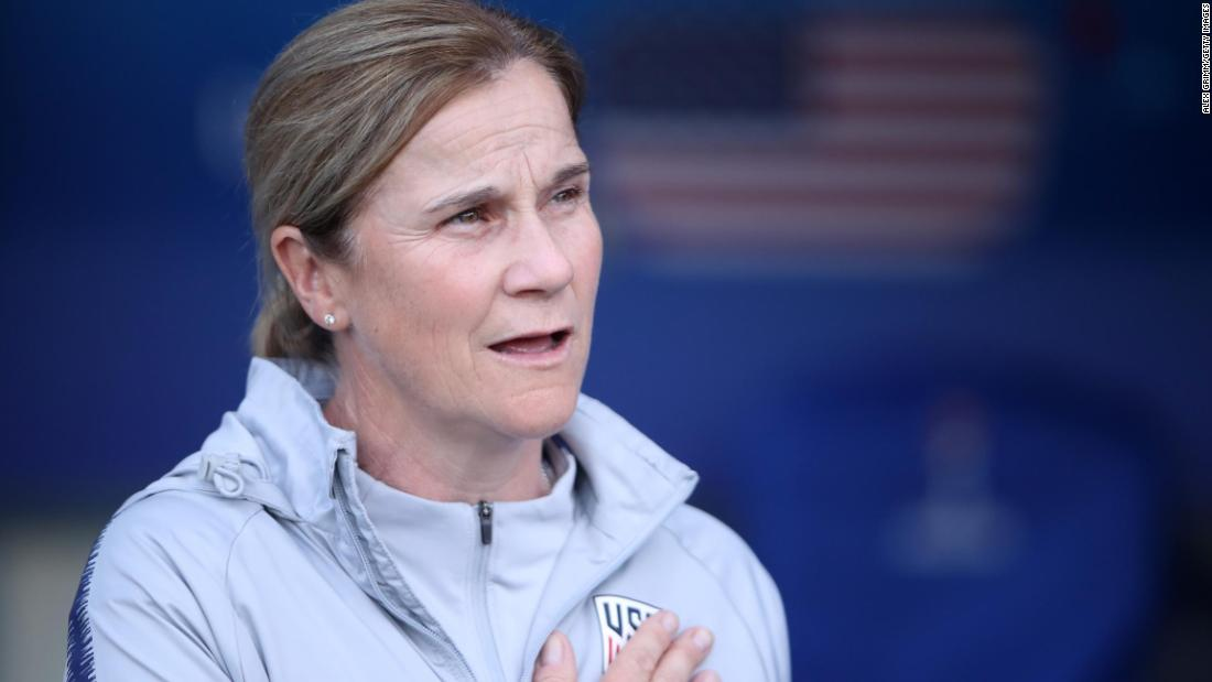 US head coach Jill Ellis sings the National Anthem before the group-stage match against Chile. Ellis was also the coach when the US team won the World Cup four years ago.