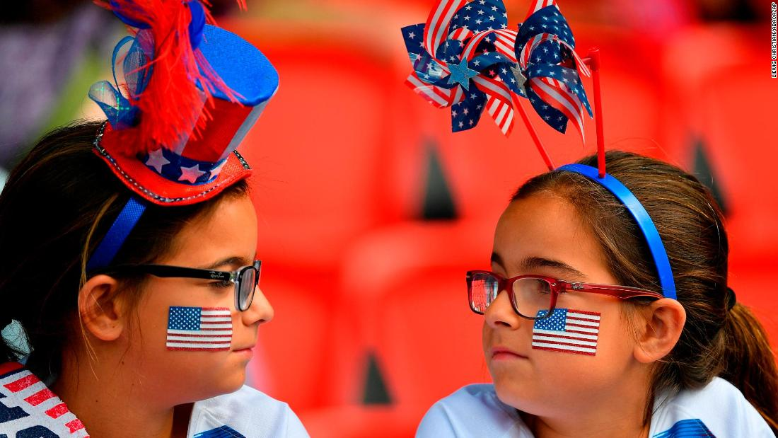 Young US fans watch the match against Chile.