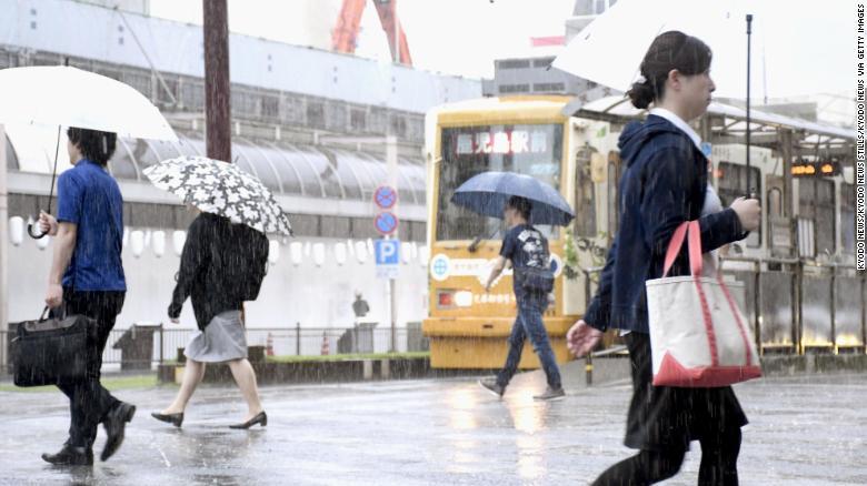 People in  Kagoshima, southwest Japan, on July 3, 2019.