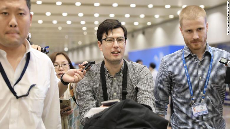 "Sigley told reporters that he was doing ""great"" after arriving at Beijing airport."