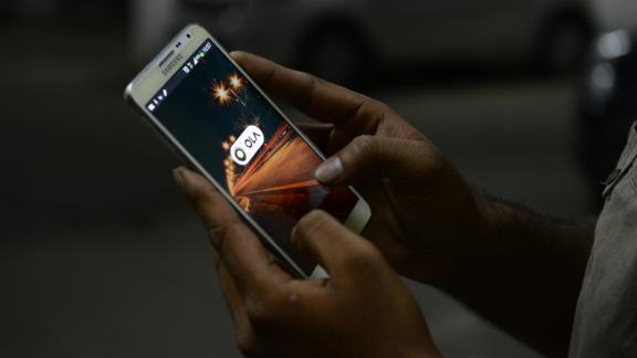 BENGALURU, INDIA - OCTOBER 1: OLA cabs booking using mobile app on October 1, 2015 in Bengaluru, India. (Photo by Hemant Mishra/Mint via Getty Images)