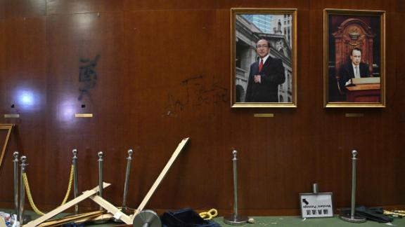 Damaged paintings are seen during a media tour of the Legislative Council in Hong Kong.