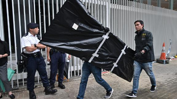 Police carry evidence out of the Legislative Council in Hong Kong on July 3, 2019, two days after protesters broke into the complex.