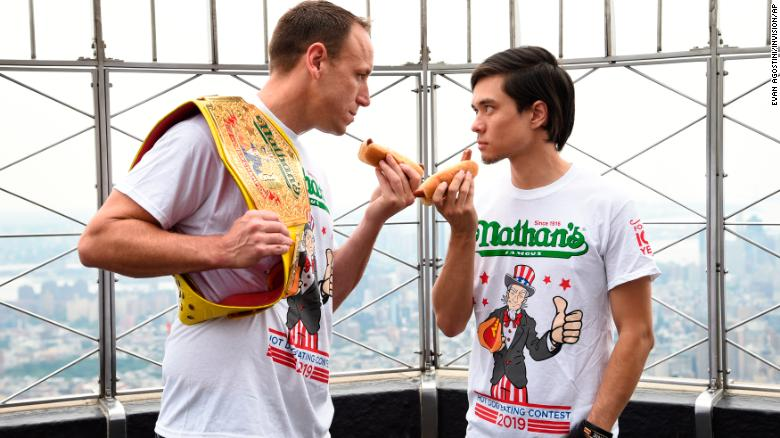 Defending men's champion Joey Chestnut, left, and former champion Matt Stonie during the contest weigh-in on Wednesday at the Empire State Building in New York. (Photo by Evan Agostini/Invision/AP)