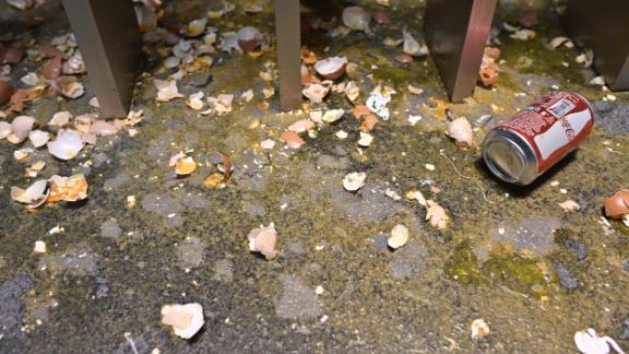 Egg shells and other debris are seen on the ground floor during a media tour of the Legislative Council, Wednesday.