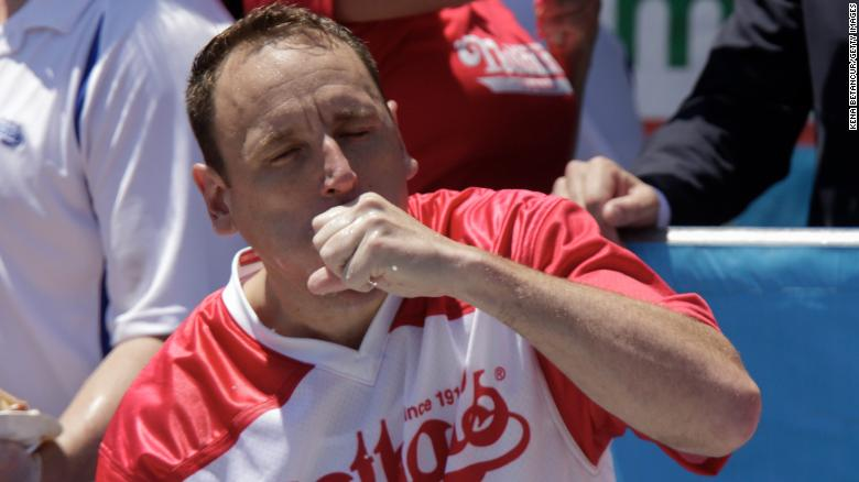 Joey Chestnut, who won the men's competition, wolfed down 71 hot dogs on Thursday. (Photo by Kena Betancur/Getty Images)
