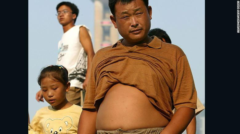 Residents outside as temperatures soar in Shanghai, August 4, 2005.