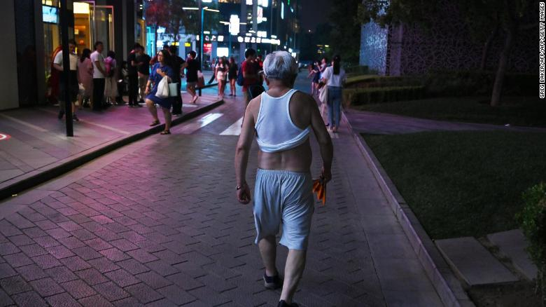 A man sports a Beijing bikini as he walks outside a shopping mall in Beijing on June 28, 2019.