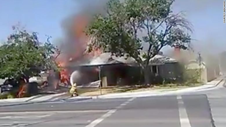 Firefighters battle a house fire in Ridgecrest, California.