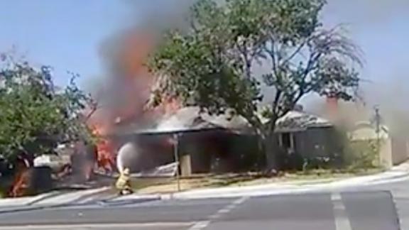 Firefighters battle a house fire in Ridgecrest, California.