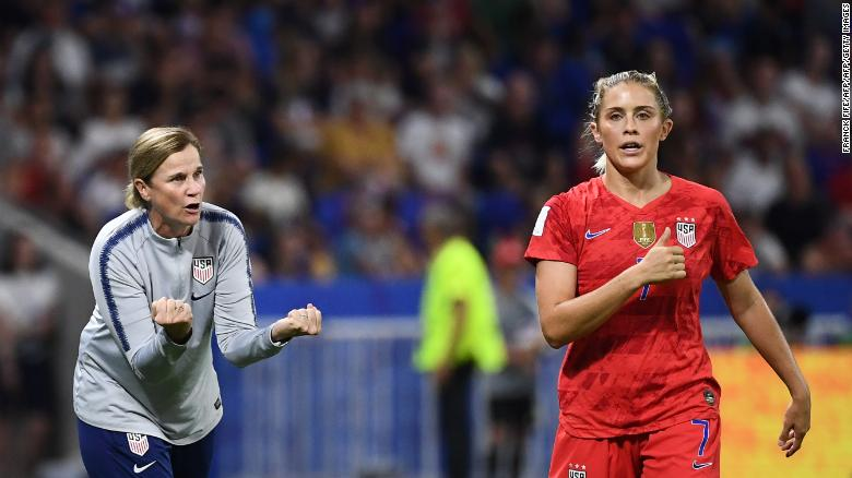 Ellis speaks to defender Abby Dahlkemper during the semi-final against England.