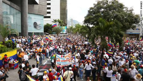 "Venezuelans gather to protest on Independence Day, convened by opposition leader Juan Guaido. The motto of the protest is ""No more torture."""