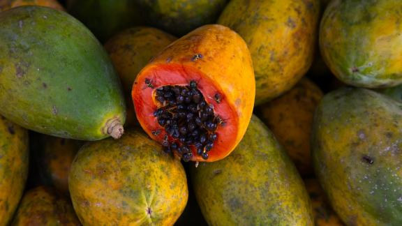 ABENGOUROU, IVORY COAST - MAY 09: Orange open papaya with black seeds, Moyen-Comoé, Abengourou, Ivory Coast on May 9, 2019 in Abengourou, Ivory Coast. (Photo by Eric Lafforgue/Art in All of Us/Corbis via Getty Images)