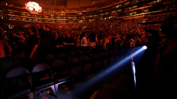 An usher uses a flashlight to clear the front row during an earthquake that struck before a Shawn Mendes concert at Staples Center in Los Angeles on Friday.