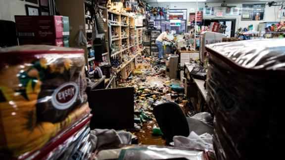 Mandatory Credit: Photo by ETIENNE LAURENT/EPA-EFE/Shutterstock (10329010j) An employee, Sam stands behind the counter amid fallen bottles that smashed on the ground after an earthquake, at a gas station and liquor store in Ridgecrest, California, USA, 06 July 2019. A 7.1 magnitude earthquake, the second hitting in as many days, located in the same area some 11 miles from Ridgecrest and 150 miles North of Los Angeles shook Southern California on 06 July night. Second earthquake hits Ridgecrest in Southern California, USA - 06 Jul 2019