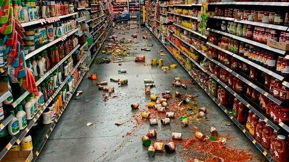 Food that fell from shelves litters the aisle at a Walmart in Yucca Valley, California, following the earthquake on Friday.