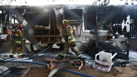 Firefighters work to put out a house fire the morning after a 7.1 magnitude earthquake struck in the area of Ridgecrest, California.