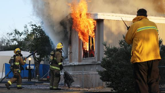 Firefighters battle a house fire on Saturday, July 6, 2019 in Ridgecrest, California, the morning after a 7.1 magnitude earthquake struck the area.