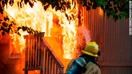 Firefighters battle an electrical fire in a mobile home park in Ridgecrest, California, on July 6, 2019 following a magnitude 7.1 earthquake on July 5. - Emergency rescue crews fanned out Saturday to assess damage from the second powerful earthquake to hit Southern California in as many days -- a 7.1 magnitude tremor that revived fears of the so-called Big One the region has feared for decades. No fatalities or serious injuries have been reported from this second quake, the largest in Southern California in more than two decades. (Photo by Robyn Beck / AFP)        (Photo credit should read ROBYN BECK/AFP/Getty Images)