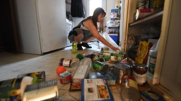 Tammy Sears cleans up her kitchen on July 6 after a magnitude 7.1 earthquake dumped food items on the floor at her mobile home in Ridgecrest.