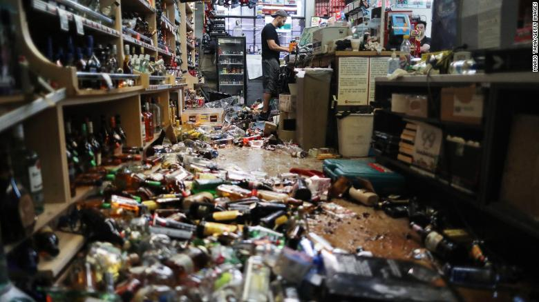 An employee at the cash register of Eastridge Market  in Ridgecrest following a 7.1 magnitude earthquake in the area last week.