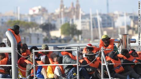 Migrant rescue ship arrives in Italian port in defiance of Salvini