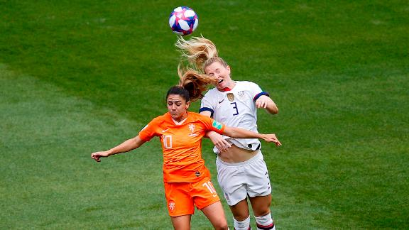American midfielder Samantha Mewis, right, and Dutch midfielder Danielle van de Donk compete for a header in the early minutes of the final.