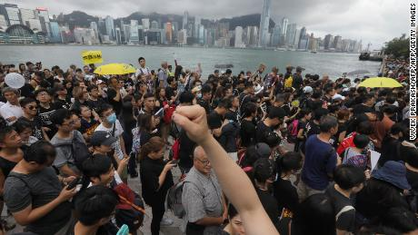 Protesters gather to take part in a march to the West Kowloon railway station.