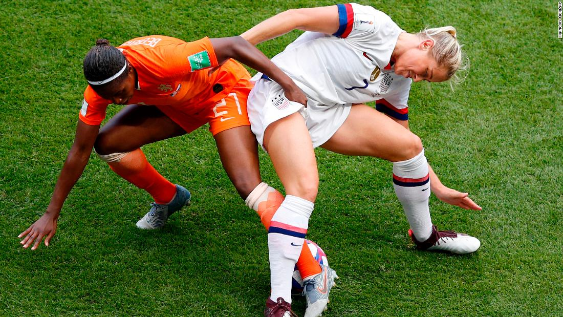 US defender Abby Dahlkemper battles Lineth Beerensteyn for the ball.