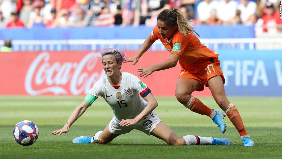 Rapinoe is challenged by Van de Donk in the first half.