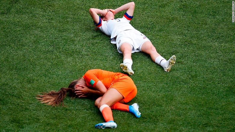 The Netherlands' Lieke Martens and the US' Kelley O'Hara lie on the field after a collision late in the first half. O'Hara had to be substituted at halftime.