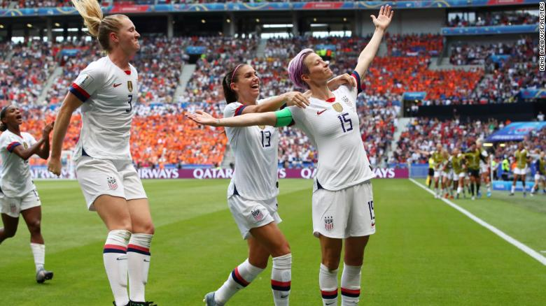 US players celebrate after Megan Rapinoe, right, scored the opening goal off a penalty in the 61st minute.