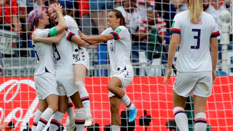 The Americans celebrate after Rose Lavelle, third from left, scored the game's second goal in the 69th minute.
