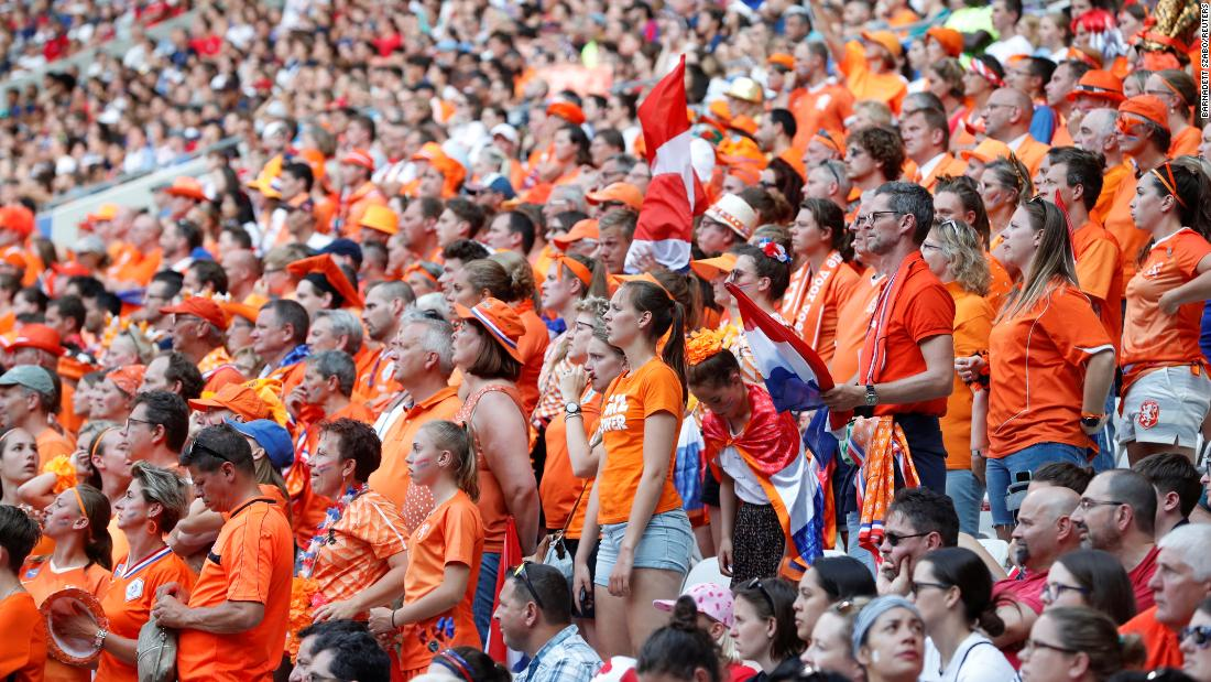 Dutch fans watch the match from inside the stadium.