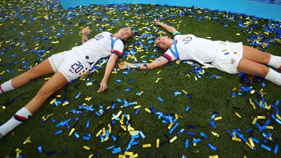 Allie Long, left, and Alex Morgan celebrate in the postgame confetti.