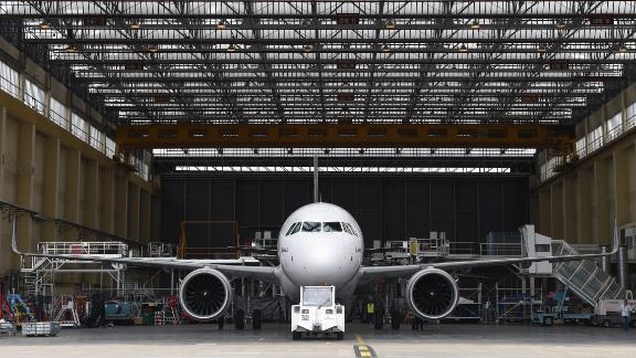 The first copy for test of the 200 medium-haul Airbus A320neo passenger plane leaves its hangar  on July 1, at the Airbus plant in Saint-Martin-du-Touch, near Toulouse, southern France. AFP PHOTO ERIC CABANIS