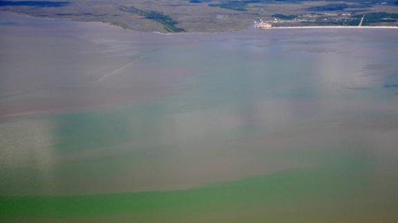 A toxic algae bloom can be seen from the air along the Mississippi coast on June 25, 2019
