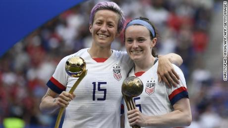 United States' forward Megan Rapinoe poses with the Golden Ball next to United States' midfielder Rose Lavelle with the Bronze Ball after the France 2019 Womens World Cup football final match between USA and the Netherlands, on July 7, 2019, at the Lyon Stadium in Lyon, central-eastern France. (Photo by CHRISTOPHE SIMON / AFP) / The erroneous mention[s] appearing in the metadata of this photo by CHRISTOPHE SIMON has been modified in AFP systems in the following manner: [Bronze Ball] instead of [Silver Ball]. Please immediately remove the erroneous mention[s] from all your online services and delete it (them) from your servers. If you have been authorized by AFP to distribute it (them) to third parties, please ensure that the same actions are carried out by them. Failure to promptly comply with these instructions will entail liability on your part for any continued or post notification usage. Therefore we thank you very much for all your attention and prompt action. We are sorry for the inconvenience this notification may cause and remain at your disposal for any further information you may require.        (Photo credit should read CHRISTOPHE SIMON/AFP/Getty Images)