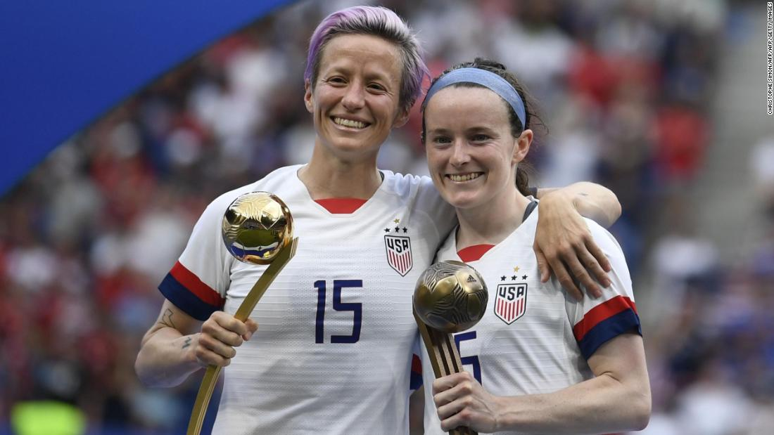 Megan Rapinoe poses with the Golden Ball next to Rose Lavelle with the Bronze Ball.