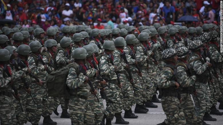 Members of the National Army march during a Venezuela Independence Day military parade in Caracas, Venezuela, on Friday, June 5, 2019.